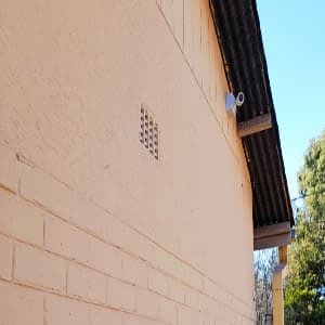 Hikvision Bullet cam mounted on side of house